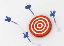 Missed the Target. Blue arrows all missed the target dartboard 3D rendered Stock Photos