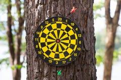 Dart board game mistake. Missed target dart board stock photo