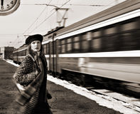 Missed train, hasten woman on railroad station. Hasten woman missed the train and look at the clock on railroad station Royalty Free Stock Photo