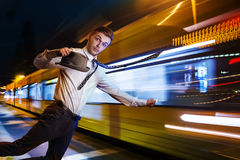 Missed the tram. Imange of a young man who was late at night on the tram Royalty Free Stock Photos