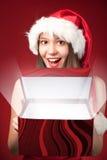 Misser Santa's die de gift openen! Stock Afbeeldingen