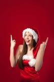 Misser Santa's die iets boven haar toont. Stock Afbeelding