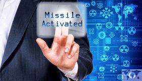 Missile activated. Man activating the missile pushing the button Stock Image