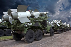 Missile Carriers. A convoy of military trucks with  anti aircraft missiles Stock Photo