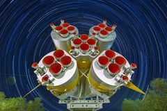 Missile engines of the first and second steps of the Soyuz rocket. Startrails background. stock images