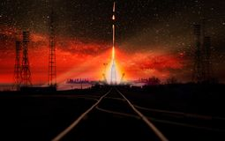 Missile launch at night. Dark sky with light flares and red sky, railway track at the first stage. The elements of this image furnished by NASA stock photo