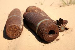 Missile and mine. In the sand Stock Photography