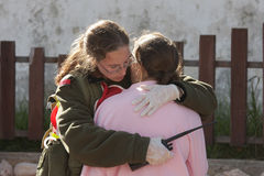 Missile strike on Israel. An israeli soldier from the rescue team holds and hugs young girl who was witness of missile launched by Hamas terrorists from Gaza Royalty Free Stock Photos