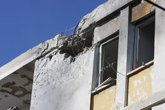 Missile strike on Israel. Hole and broken windows in the apartment building caused by explosion of missile launched by Hamas terrorists Stock Images