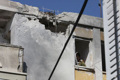 Missile strike on Israel. Hole and broken windows in the apartment building caused by explosion of missile launched by Hamas terrorists Royalty Free Stock Image
