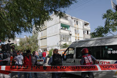 Missile strike on Israel. Residents of the apartment building and soldiers from the rescue team in front of the damaged building short time after missile hit Royalty Free Stock Image