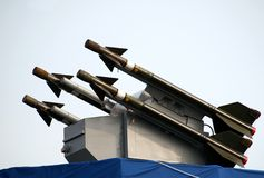 Missile System. A surface-to-air missile battery mounted on a destroyer Royalty Free Stock Photos