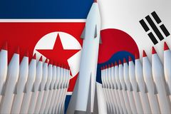 Missiles of North Korea and South Korea in a row and their flags Royalty Free Stock Photo