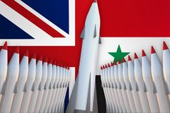 Missiles of United Kingdom and Syria in a row and their flags Royalty Free Stock Photo