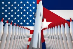 Missiles of USA and Cuba in a row and their flags Royalty Free Stock Photos