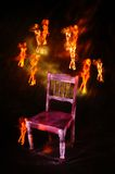Missing. Old chair with light painted affiar dolls Royalty Free Stock Photos