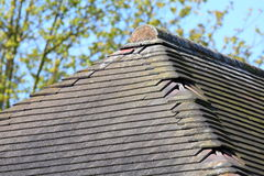 Missing damaged roof tiles Royalty Free Stock Photo
