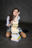 Missing girl on the pile of books Stock Photography