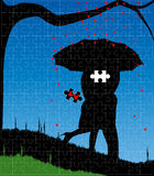 Missing Heart. A courting couple, silhouette, kissing under an umbrella, during a downpour of red cupids hearts set into a jigsaw frame with the heart missing Stock Photography