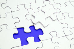 Missing Jigsaw Piece. Jigsaw puzzle with a missing piece Stock Images