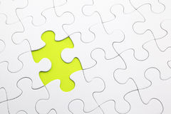 Missing Jigsaw puzzle. In green Royalty Free Stock Photography