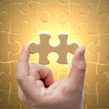 Missing jigsaw puzzle piece. With light glow, business concept for completing the final puzzle piece Stock Photography