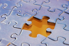 Missing Jigsaw puzzle piece. A single missing piece in a jigsaw puzzle in blue Stock Photography