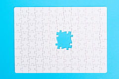 Missing jigsaw puzzle piece . Close up of the last jigsaw puzzle Royalty Free Stock Photos