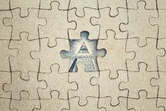 Missing jigsaw puzzle piece and dollar all-seeing eye . Business concept. Missing jigsaw puzzle piece and dollar pyramid all-seeing eye inside. New world order royalty free stock photos