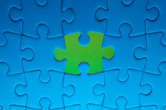 Missing jigsaw puzzle piece with light glow Royalty Free Stock Photos
