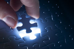 Missing jigsaw puzzle piece with light glow Stock Photo