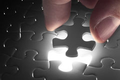 Missing jigsaw puzzle piece with light glow Royalty Free Stock Photography