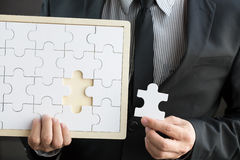 Missing jigsaw puzzle piece. Search successful business concept Royalty Free Stock Photography