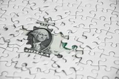 Missing jigsaw puzzle pieces on money dollar background, Busines. S solution concept ,key for success Royalty Free Stock Photos