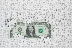 Missing jigsaw puzzle pieces on money dollar background, Busines. S solution concept ,key for success Stock Photo