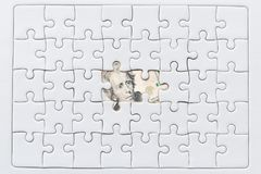 Missing jigsaw puzzle pieces on USA dollar background. Business solution concept Stock Image