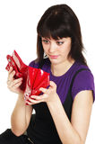 Missing money. Teenage girl looking with surprise into red purse stock photos