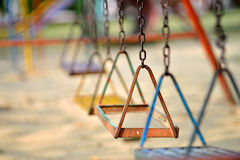 The missing part. At abandon playground a swing have missing part Stock Photos