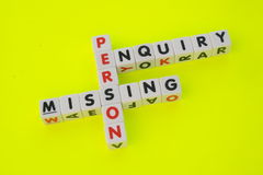 Missing person enquiry. Text ' missing ', ' person ' and ' enquiry ' inscribed in uppercase letters on small white cubes and arranged crossword style with common Royalty Free Stock Photos