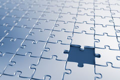 Missing piece. Blank puzzle with a missing piece - shallow depth of field Stock Images