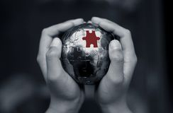 The Missing Piece. Picture of earth puzzle held by a child Royalty Free Stock Photos