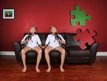 Missing piece. Two girls looking at a missing piece of wall Royalty Free Stock Photos
