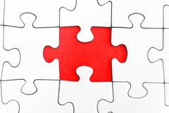 Missing Piece. Missing jigsaw piece in a blank puzzle Stock Images