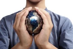 The Missing Piece. Earth puzzle, held by a young boy looking for solution Stock Image