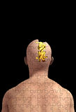 Missing Piece Of Mind With Brain. Concept image showing a man made out of jigsaw pieces with his brain exposed Royalty Free Stock Photo