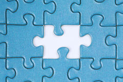 The missing piece in a puzzle Stock Photos