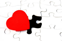 Missing piece of the puzzle. Heart in puzzle Stock Photography