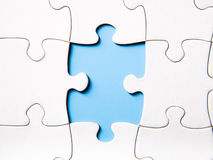 Missing a piece of a puzzle Stock Image