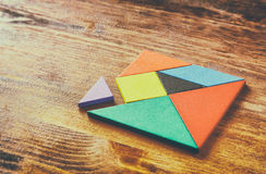A missing piece in a square tangram puzzle, Royalty Free Stock Image