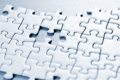 Missing puzzle piece. Jigsaw puzzle assembled with a piece missing Stock Photography